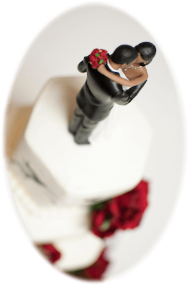wedding cake with a cake topper that looks like a bride and groom